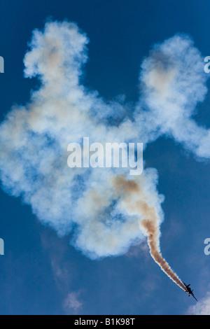 Stunt flying with lot of smoke, Airshow Maribor 2008, Slovenia June 15, 2008 - Stock Image