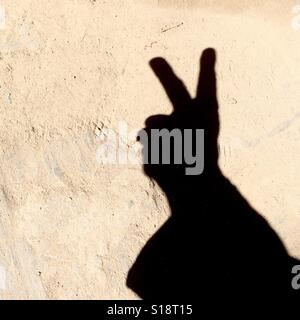 Counting with fingers - two - Stock Image