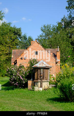 water well in front of summer kitchen outhouse in rural village house garden zala county hungary - Stock Image