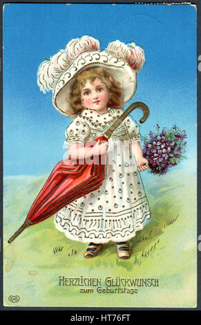 A greeting postcard printed in Germany, shows a little girl with a hat and umbrella. The inscription in German: - Stock Image