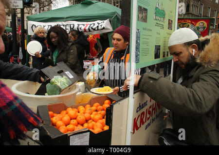 London, UK - 16 March 2019: A caterer serves free food to demonstrators at Park Lane as thousands of people took part in the UN Anti-Racism Day demonstration that took place in central London on 16 March. The demonstration which began in Park Lank and ended outside Downing Street was organised by Stand Up to Racism and Love Music Hate Racism and supported by the TUC and UNISON. Photo: David Mbiyu - Stock Image