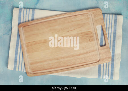 napkin, cutting board on a blue background concrete. view from above. copy space. toning - Stock Image