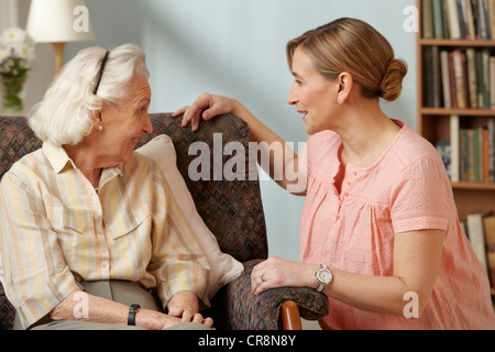 Daughter visiting senior mother in care home - Stock Image