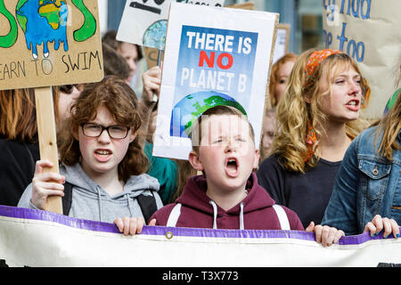 Bath, Somerset, UK. 12th April, 2019.  Bath college students and school children carrying climate change placards and signs are pictured as they take part in a climate change protest march through the centre of Bath. The pupils also walked out of school in February and March as part of a countrywide coordinated strike action to force action on climate change policy. Credit: Lynchpics/Alamy Live News - Stock Image