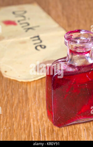 Small glass bottle with drink me label - Stock Image
