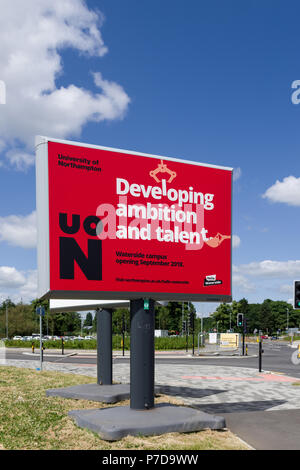 Red roadside sign advertising the new University of Northampton, Waterside Campus, site due to open in September 2018; Northampton, UK - Stock Image