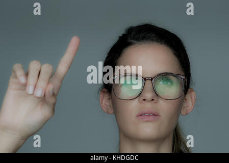 Young woman using touch screen technology - Stock Image