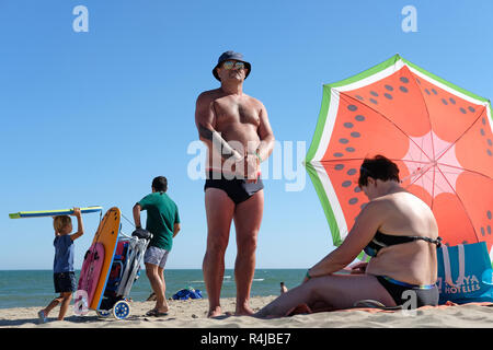 Family beach life in Spain. - Stock Image