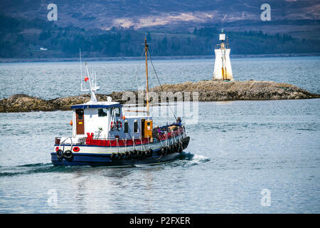 The Western Islands Ferry leaves Mallaig Harbour in the Lochaber district of the Highlands of Scotland. - Stock Image