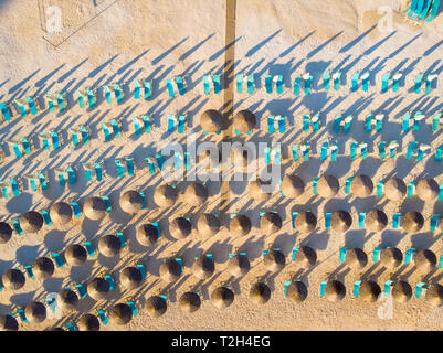 Aerial top down view of Porto Vathy Beach sunchairs and umbrellas - Stock Image