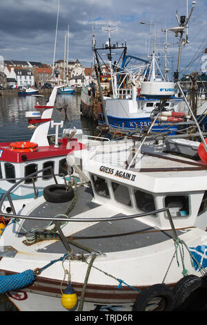 Village of Pittenweem, Scotland. Picturesque view of Pittenweem Harbour with fishing boats moored in the foreground. - Stock Image