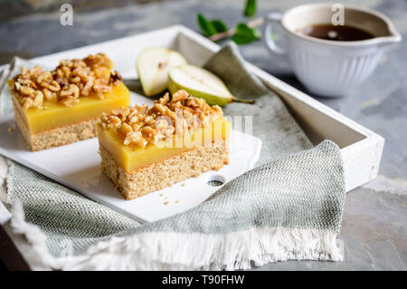 Homemade pear bars with wholegrain dough, walnut and maple syrup - Stock Image