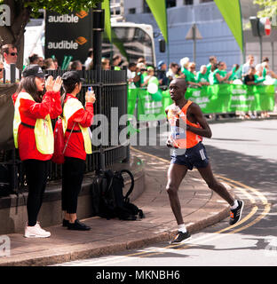 Daniel  Wanjiru  competing for Kenya, in the 2018 Men's Elite  London MArathon. He went on to finish 8th, in a time of 02:10:35 - Stock Image