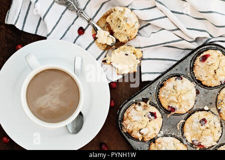 Coffee and cranberry muffins. Image shot from above. - Stock Image