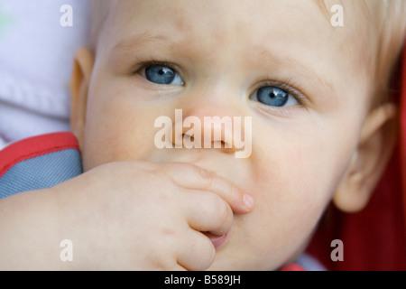 blue child eyes face girl Penelope sad tears toddler young - Stock Image