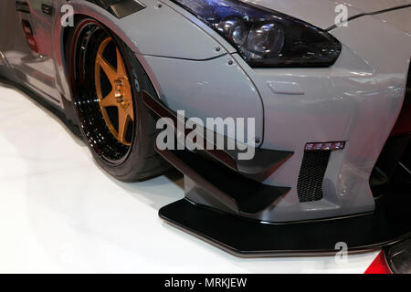 Close-up of the front of a  liberty Walk  modified Aston Martin, , on display at the 2018 London Motor Show - Stock Image