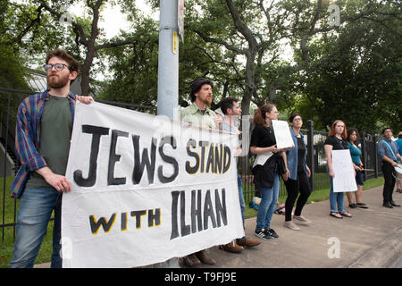 Supporters of controversial Congresswoman Ilhan Omar of Minnesota counter-demonstrate against anti-Muslim protesters as she spoke at Austin's annual city-wide iftar dinner in honor of the 14th day of Ramadan. Omar is one of two Muslims serving in the United State Congress. - Stock Image