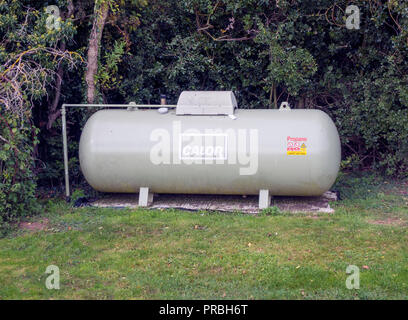 A Calor Propane gas storage cylinder supplying gas fuelling a restaurant in a rural location - Stock Image