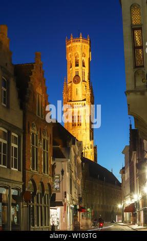 Belfry of Bruges and night street in Bruges, Flemish Region, Belgium - Stock Image