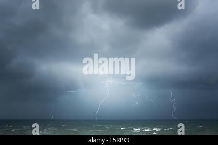 thunderstorm with lightning on the sea - Stock Image