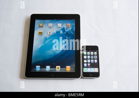 iPhone compared in size to Apple iPad, TouchscreenTablet Computer, Book Reader, Digital Ebook, Modern, Logo, Brand, - Stock Image