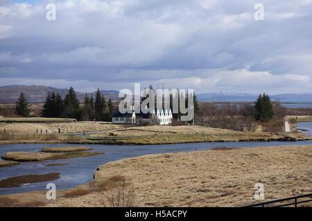River flowing through barren terrain - Stock Image