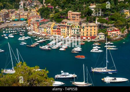 Boats moored in the tiny harbor town of Portofino, Liguria, Italy - Stock Image