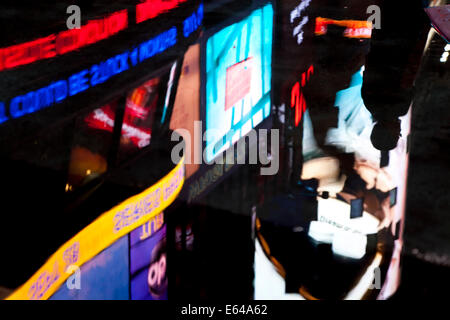 Reflections of neon in Times Square, Manhattan, New York, USA - Stock Image