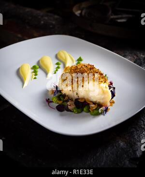 Baked Crumbed Cod white Fish - Stock Image