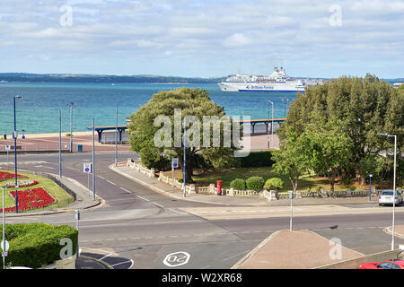 A Brittany ferry passes though the Solent on its way to France with the Isle of Wight in the background - Stock Image