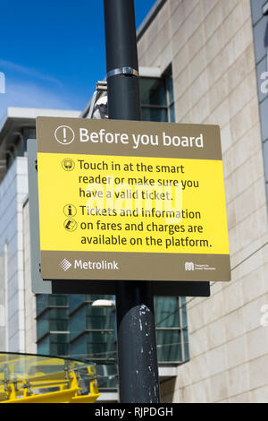 Sign at a Manchester Metrolink tram station warning passengers to make sure they have a valid ticket before boarding. - Stock Image