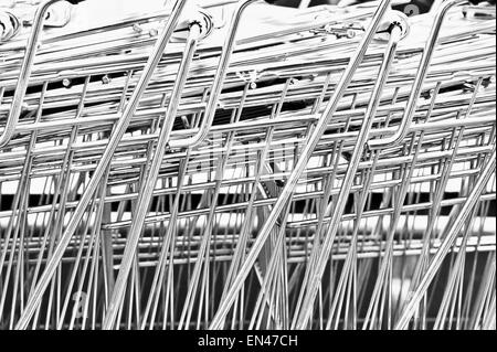 Close up of metal shopping trolleys making an abstract pattern - Stock Image