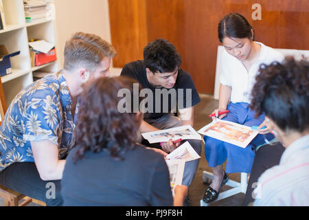 Creative designers reviewing proofs - Stock Image