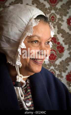 A museum attendant, in 19th Century Cape Dutch costume, in one of the houses of the Village Museum, Stellenbosch, - Stock Image
