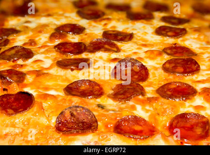 Picture of a closeup pizza with cheese and pepperoni - Stock Image