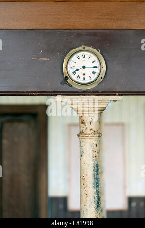 Old bulkhead clock in a church - Stock Image