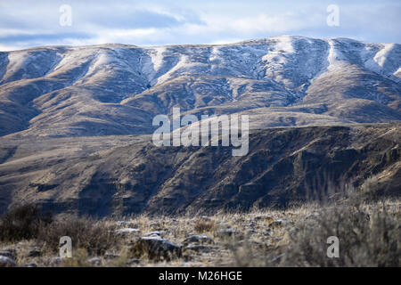 snow on the foot hills in Eastern Washington - Stock Image