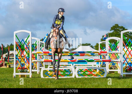 Rockingham Castle grounds, Corby, England. Saturday 20th May 2017. Katie Barber and her horse Don Meeco leap a fence - Stock Image
