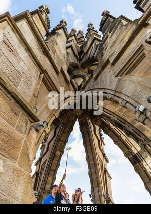 People taking a selfie at The National Wallace Monument on Abbey Craig, Stirling in Scotland - Stock Image