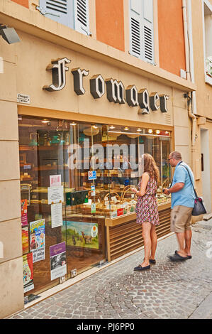 Tournon sur Rhone in the Ardeche department, Rhone Alps, France and people looking in the window of a fromage or cheese shop - Stock Image