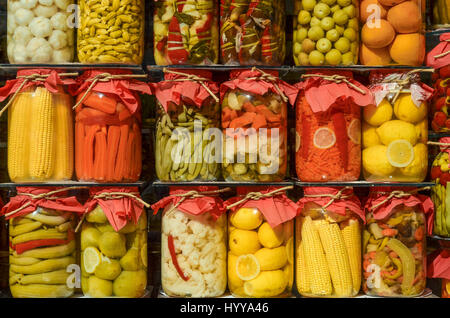 Assorted jars of pickled fruit and vegetables on display in a shop window in Istanbul. - Stock Image
