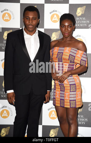 LONDON, UK. March 19, 2019: Michaela Coel arriving for the Royal Television Society Awards 2019 at the Grosvenor House Hotel, London. Picture: Steve Vas/Featureflash Credit: Paul Smith/Alamy Live News - Stock Image