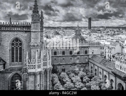 Seville cathedral  and surrounding section of Seville city, viewed from the Giralda bell tower, Seville, Andalucia, Spain - Stock Image