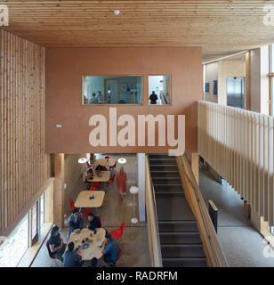 Overall view of foyer with cafe and upper floor meeting space. The Enterprise Centre UEA, Norwich, United Kingdom. Architect: Architype Limited, 2015. - Stock Image