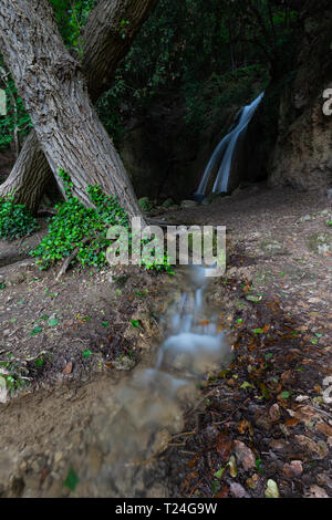 Waterfall in the woods in Pale (Umbria, Italy). - Stock Image
