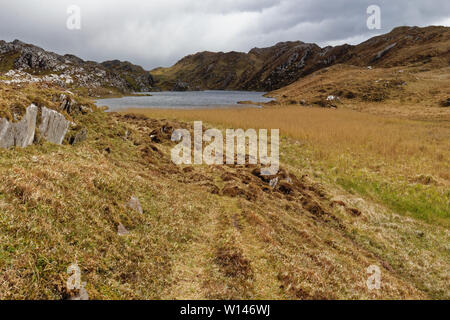Small picturesque lake surrounded by rocky hills.Located on the end of Sheep's Head Peninsula in County Cork,Ireland. - Stock Image