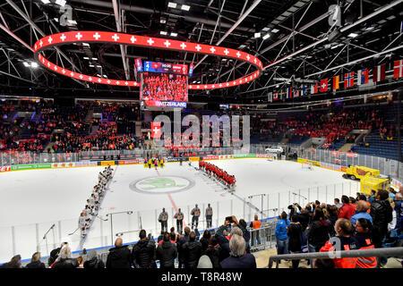 Bratislava, Slovakia. 14th May, 2019. Players listen the Swiss national anthem after the match Switzerland against Austria at the 2019 IIHF World Championship in Bratislava, Slovakia, on May 14, 2019. Credit: Vit Simanek/CTK Photo/Alamy Live News - Stock Image