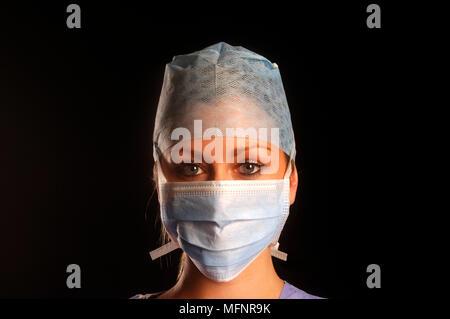 Nurse with mask   Ref: CRB425_10046_087  Compulsory Credit: Synercomm/Photoshot - Stock Image