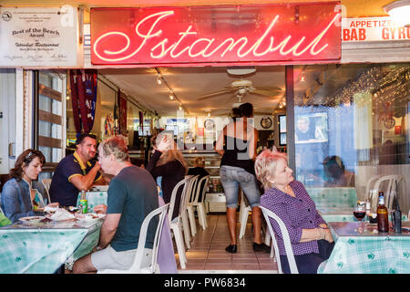 Hollywood Florida Hollywood Beach Boardwalk Istanbul Restaurant ethnic food small business tables diners woman man couple neon l - Stock Image