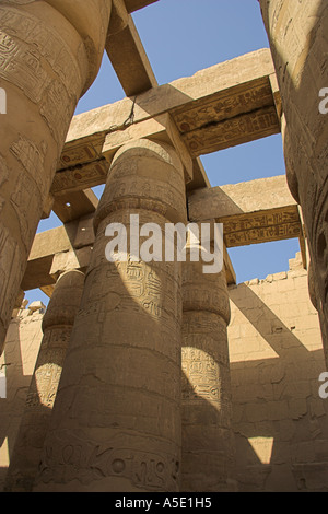 Vertical Stone Columns in the Temple of Karnak, Luxor, Egypt, Decorated with Hieroglyphics and Pictures of the Ancient - Stock Image